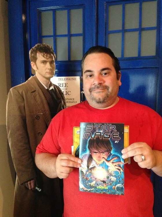 """Author and writer of """"Star Mage"""" JC De La Torre displays his new book accompanied by The Doctor."""